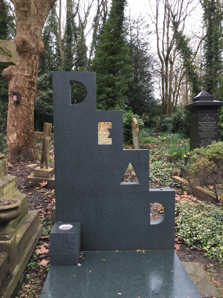 gravestone that says dead