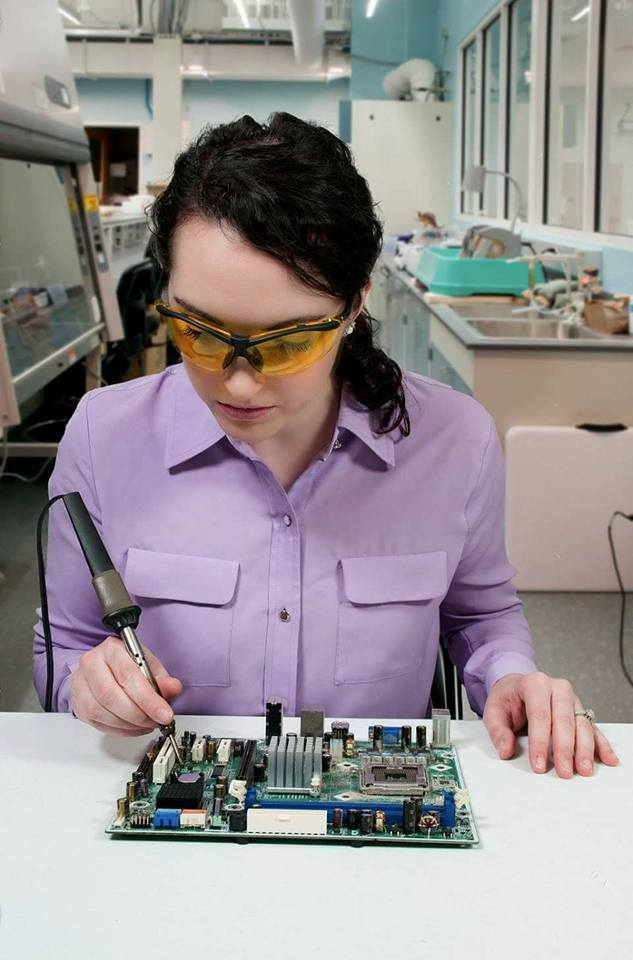 holding soldering iron