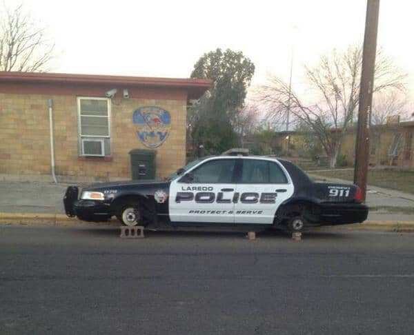 rough neighbourhood police car on bricks