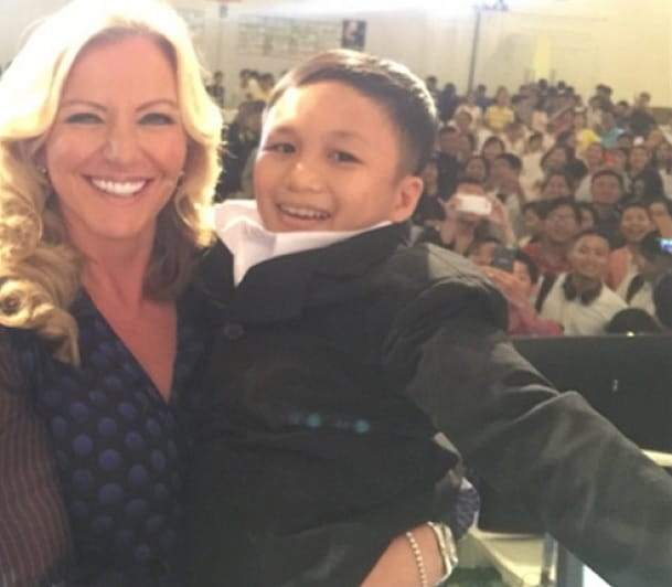 Michelle Mone picks up boy for hug, finds he's a man